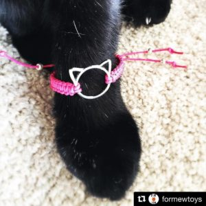 Sammy from formewtoys mewdeling our Pink Pussy Bracelet for humans!hellip